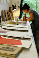 Elizabeth Thomasetti, artist-in-residence working in WSW's etching studio